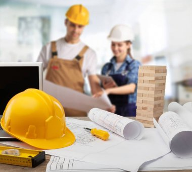Two builders while working