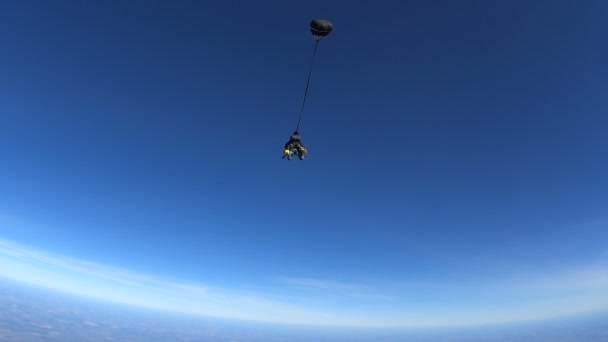 Parachutists Jumping in Tandem out of an Airplane. Slow Motion