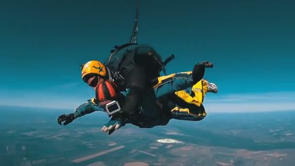 Tandem Skydiving. Tandem Jump. Parachutists in Long Free Fall