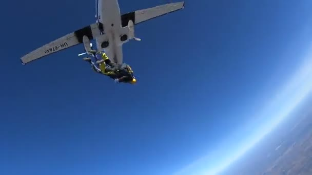 Parachutists Jumping in Tandem out of an Airplane