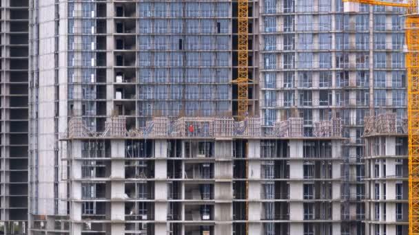 Výstavbu mrakodrapů a stavby, staveniště. Budova ve výstavbě