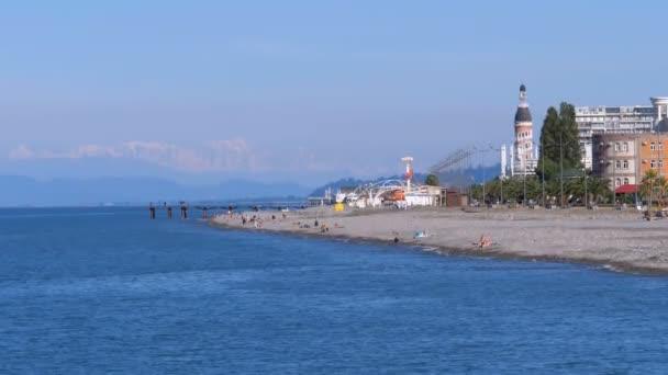 The coastline of Batumi Embankment in October. Deserted Pebbles Beach.