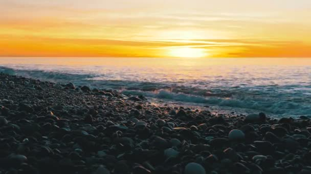 Beautiful Sunset over the Sea near the Stony Shore