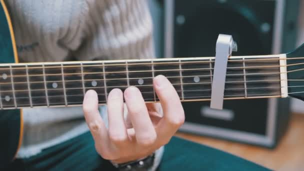 Guitarist Plays an Acoustic Guitar