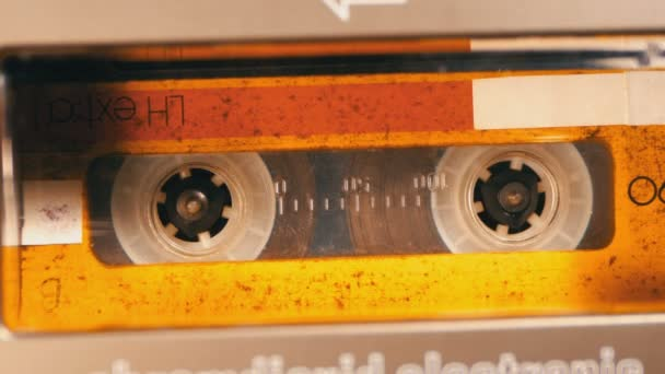 Vintage Yellow Audio Cassette in the Tape Recorder Playing and Rotates