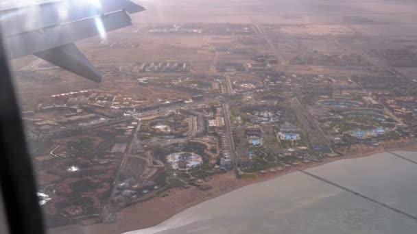View from the Airplane Window on the Tropical Resort with Exotic Hotels and Pools in Egypt Desert