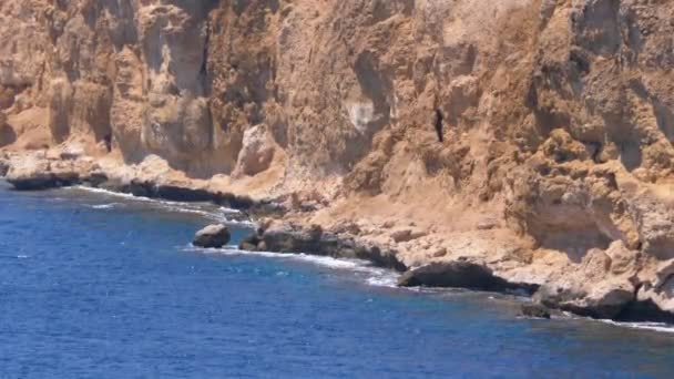 Rocky Beach in Egypt. Beach in a Bay on the Coastline with Waves in the Red Sea and Coral Reefs.