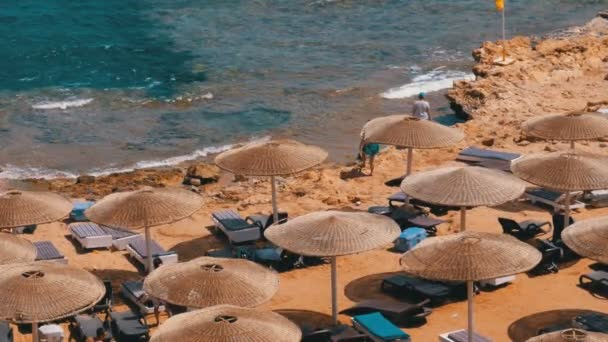 Egypt, Beach with Umbrellas and Sunbeds on Red Sea near the Coral Reef.
