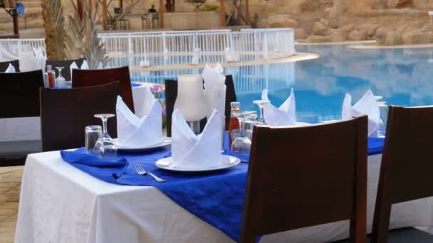 Served Table near the Swimming Pool with Blue Water in the Resort of Egypt