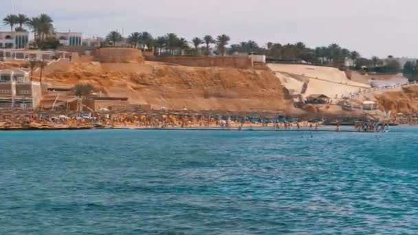 Beach with Umbrellas and Sunbeds at the Luxury Hotel on Red Sea near the Coral Reef. Egypt.