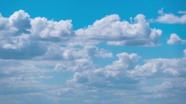 Cumulus Cirrus Clouds move in the Blue Sky. Time lapse.