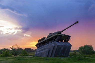 Soviet medium tank T-34-85 of the Second World War.Tank against the backdrop of the sunset and thunderstorm clouds