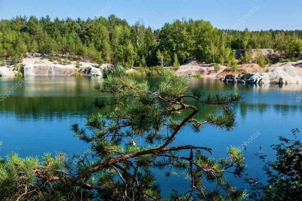 Korostyshevsky quarry flooded granite quarry on the outskirts of the city of Korostyshev in the Zhytomyr region, a tourist attraction. Labradorite, gabbro and gray granite were mined here.