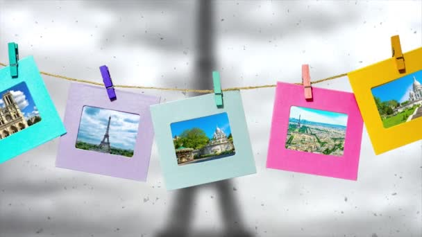 Creative slow motion parallax video of the main sights of Paris in summer in funny frames on a rope with clothespins against the backdrop of the panorama of Paris with the Eiffel Tower in winter.