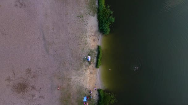 Water aerials. Straight Down Aerial View of beach on the lake. People relaxing on lake.
