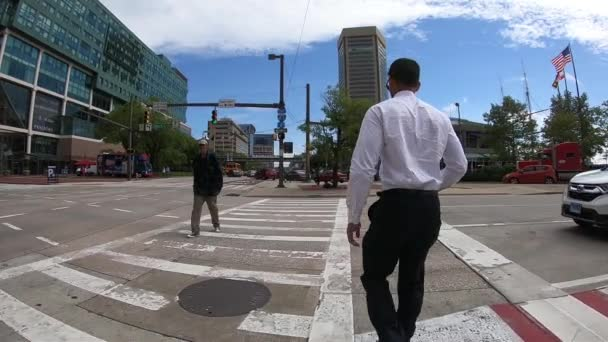 September 26, 2018  Baltimore, USA  People walking in the city on crowded  street  SLOW MOTION  POV view of city skyline, skyscrapers and buildings of  Baltimore  City traffic  Traffic passing by