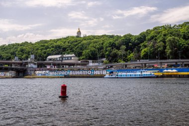 Walking throught the Dnipro river in Kyiv city, Ukraine. Landscapes and views from the boat