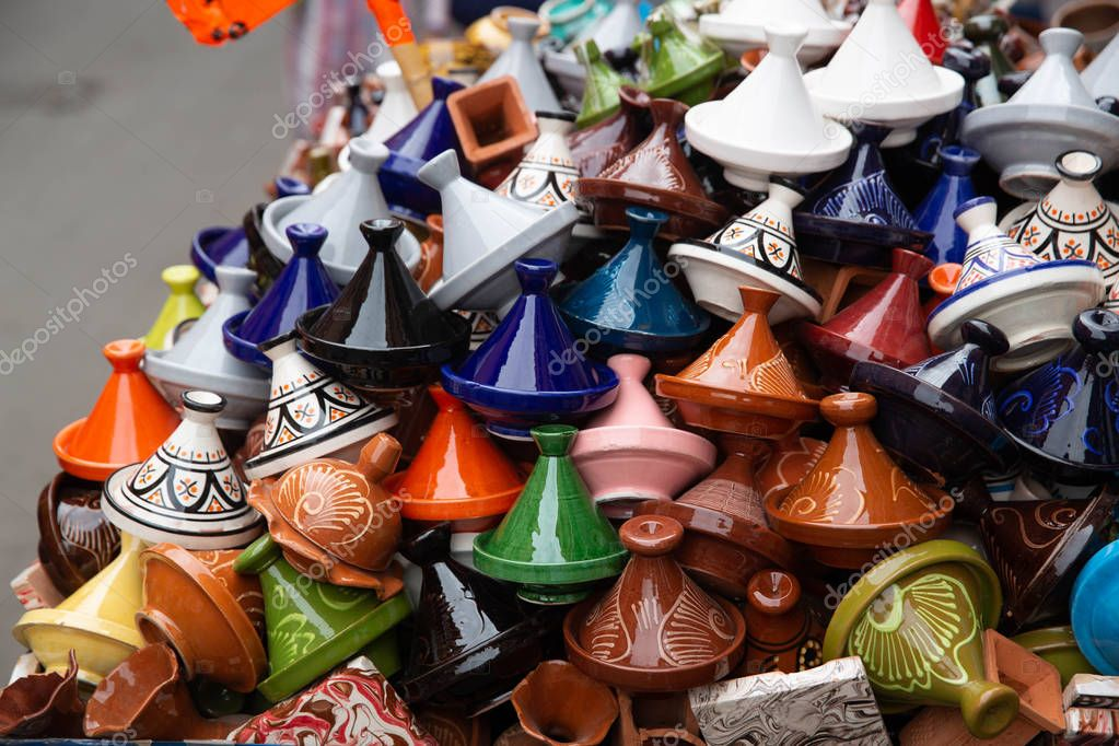 Many coloured tajines for sale in a street, background