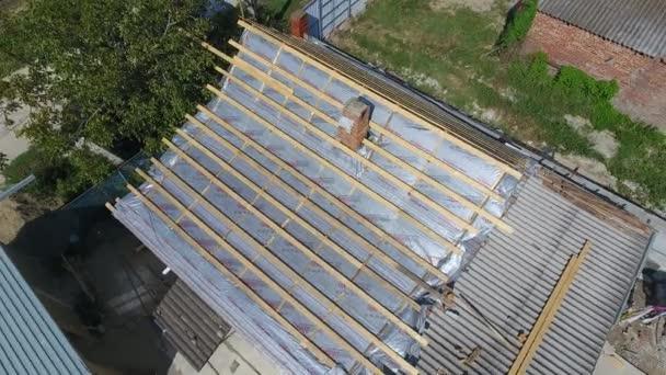 Slavyansk-on-Kubani, Russia - September 10, 2017: Repair of the roof of the house. Moisture insulation under metal.