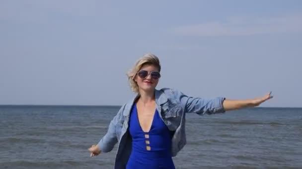 Girl dancing on the beach. Dance on the beach.