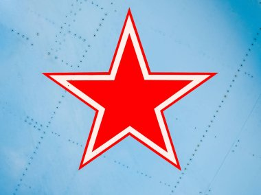 Five-pointed red star on the wing skin of a military fighter