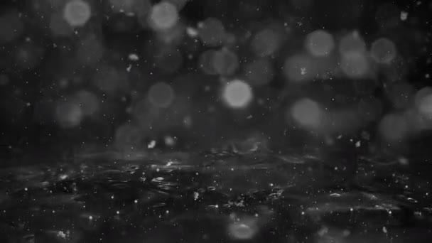 Winter White Motion background lights, snow falling on ice defocused bokeh loop