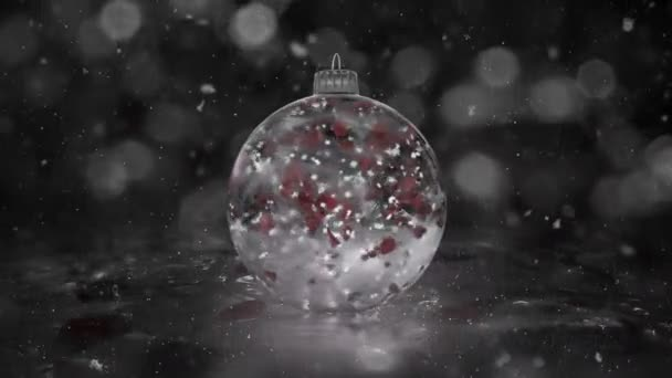 Christmas Rotating White Ice Glass Bauble snowflakes red petals background loop
