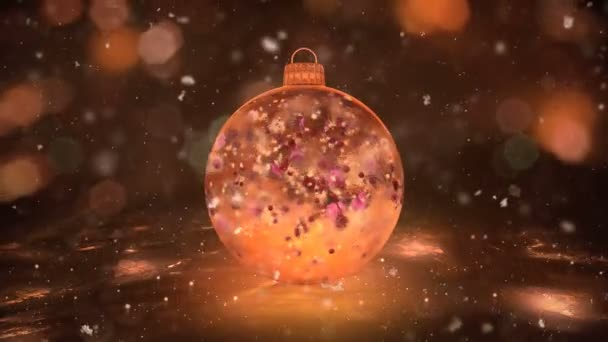 Christmas Gold Ice Glass Bauble Decoration snow colorful petals background loop