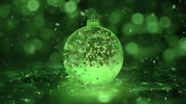 Vánoční rotující zelené ledové sklo cetka vločky červené koulí na pozadí smyčky
