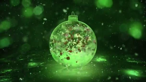 Vánoční rotující zelené ledové sklo cetka sníh barevné lístky na pozadí smyčky