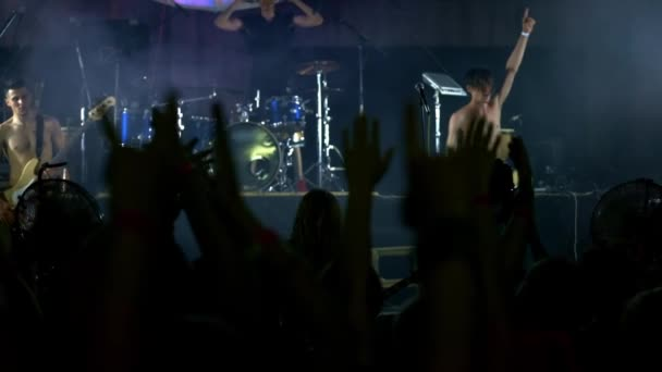 Rock star acclamation at music concert event. Heavy metal band performs a rock concert at the club.