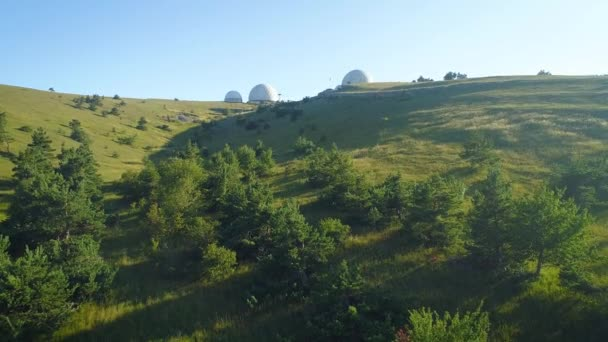 big white balls on the mountain. Observatory in Russia. Used to measure weather and radionavigation