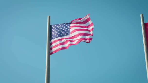 The flag of the United States of America blowing in the wind.