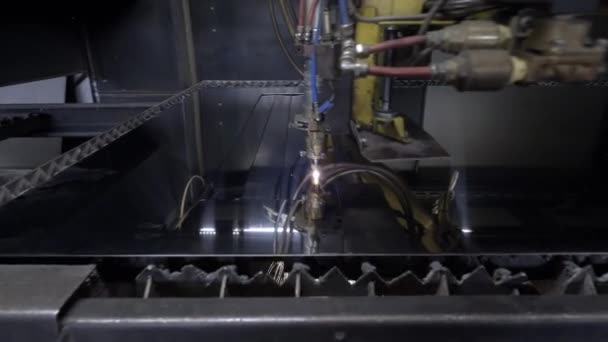 Cut sheet metal at workshop. Modern tool in heavy industry. Dangerous job. High precision manufacture of steel parts. Automation of process indoors. Automatic work for ironwork. Close up computer cnc