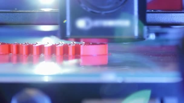 3D printer working close up. Automatic three dimensional 3d printer performs plastic. Modern 3D printer printing an object from the hot molten. Concept progressive additive technology for 3d printing.