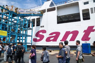 Passangers boarding at Seaworld Ferry line on Santa Lucino ship, Jeju-si, Jeju Island, South Korea