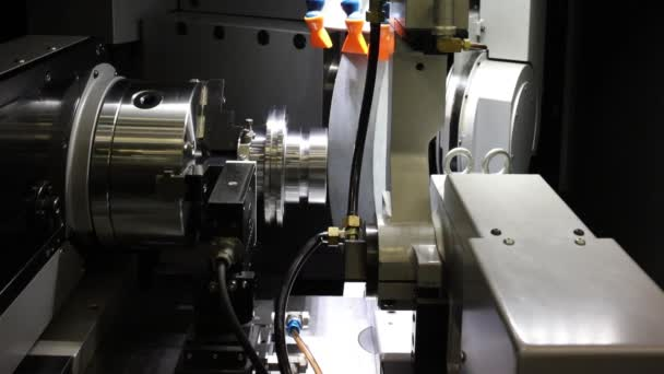 Metal blank machining process on lathe with cutting or abrasive tool  at steel manufacturing