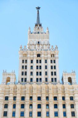 Russia style of Stalinist architecture against a blue sky with white clouds, view up. Welcome to the football world championship June 2018, Moscow, Russia