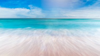 Summer sea with smooth waves blue sky sand and free space