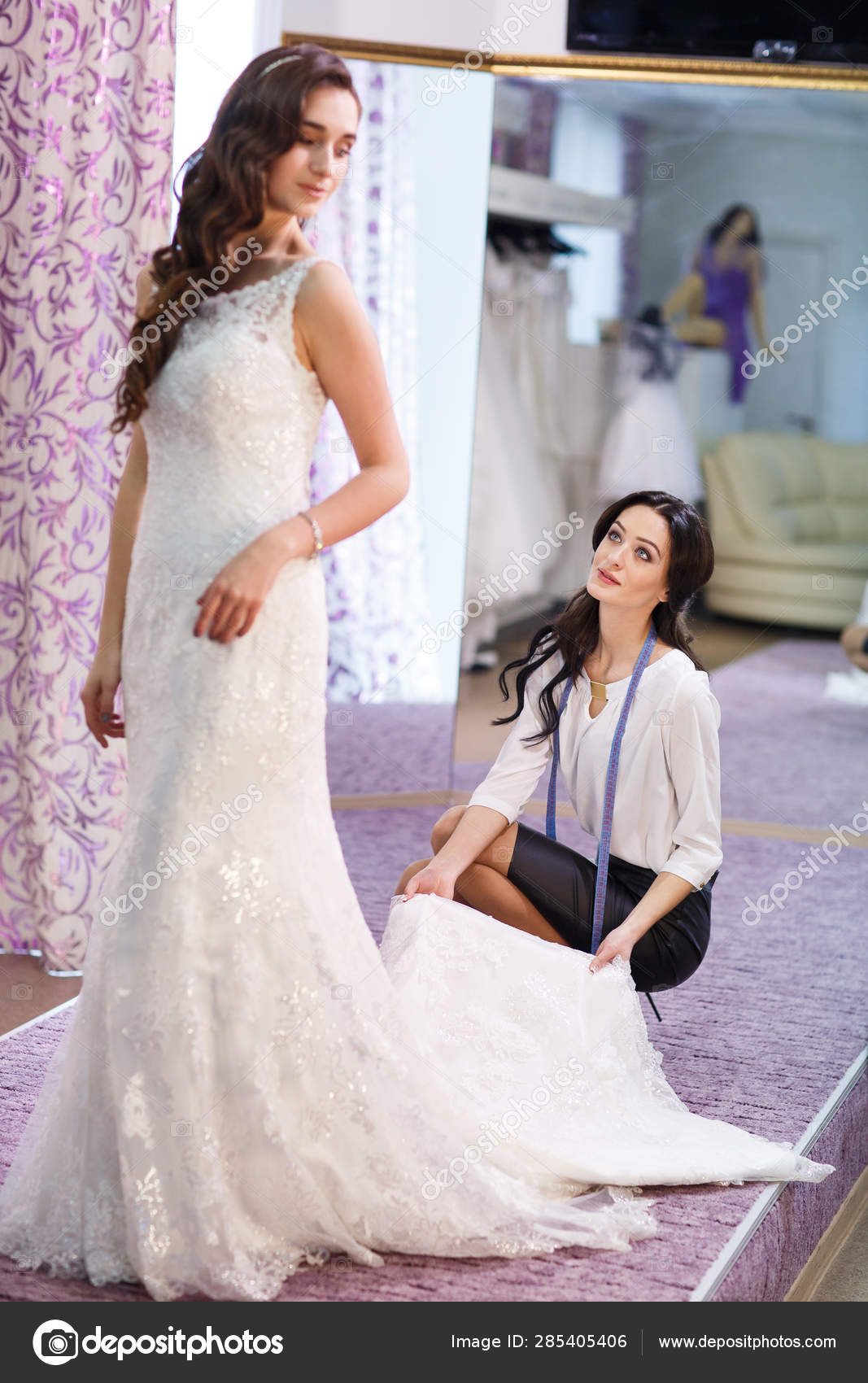 Female Trying On Wedding Dress In A Shop With Women