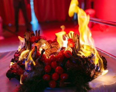 Gourmet Crown of Lamb with flame. Chefs dish
