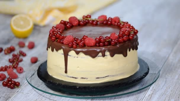 White cream cake decorated with berries. Summer berry cake.