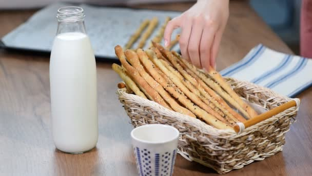 Grissini Breadsticks, Sesame-Covered Bread Sticks. Fresh bread sticks in a basket.