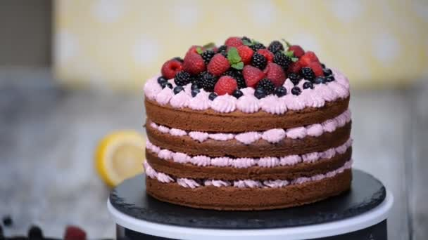 Chocolate cake decorated with berries. Summer berry cake.