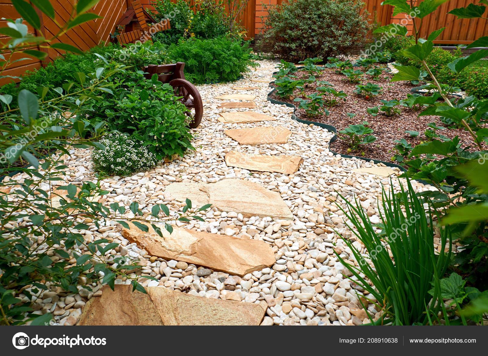 Garden Design. Pathway In Garden, Flowers With Bricks Pathways. The Care Of  Garden