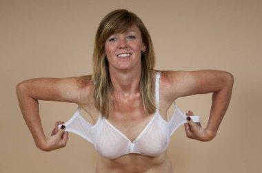 Blonde woman fastening bra
