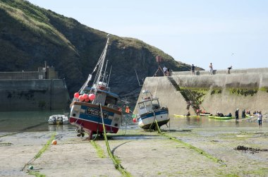 Port Isaac a north Cornwall fishing harbour at low tide