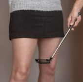 Photo Mobile phone camera on a selfie stick to take images up a womans skirt.