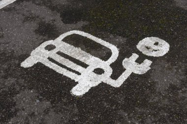 Parking bay for recharging electric vehicles. Painted sign on the tramac