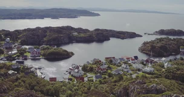 aerial village on fjord coasts boundless bay on sunny day